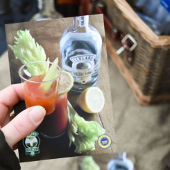 A photograph of Emma holding a taster glass with a shot of Bloody Mary made with Fenland Celery Vodka