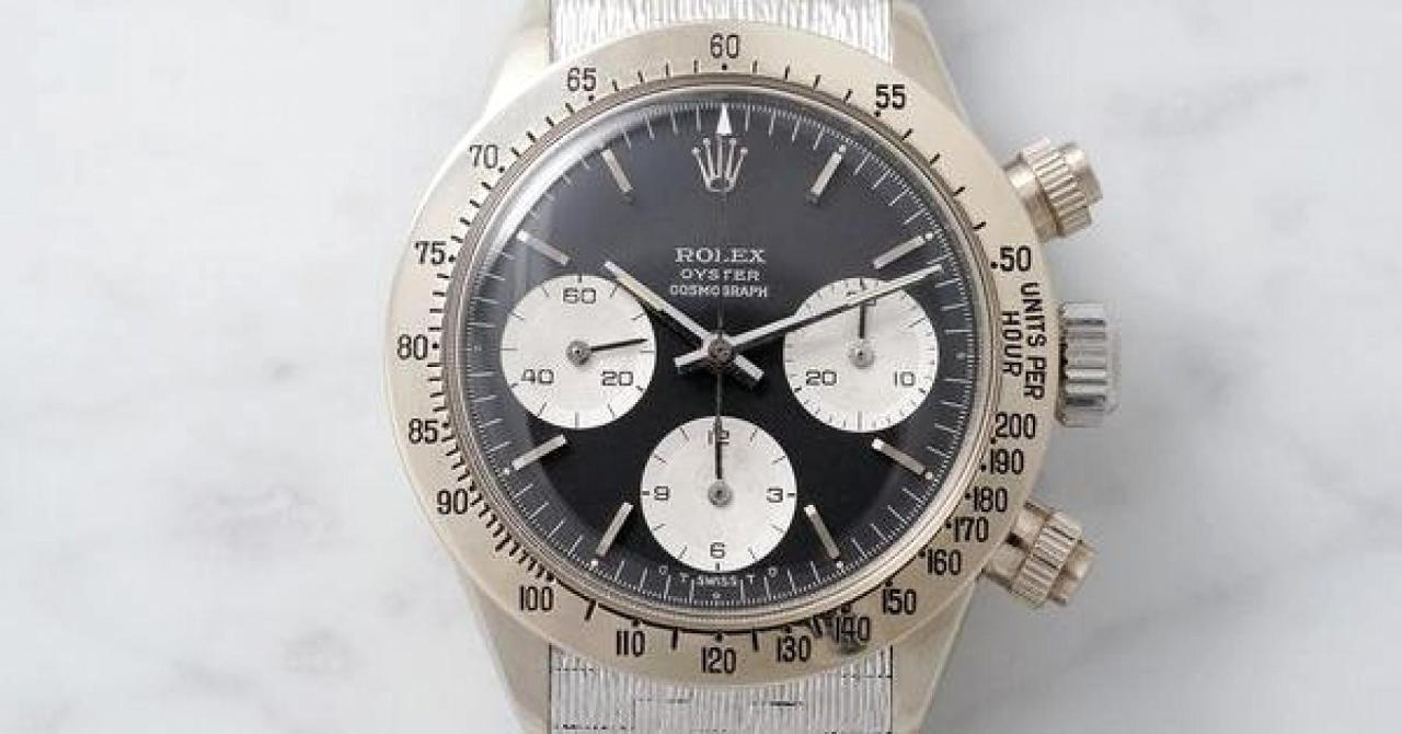 105206647-the-watch-is-fitted-with-a-sigma-dial-with-white-gold-indexes-which-are-consistent-with-the-case-met_s600x0_q80_noupscale.1910x1000