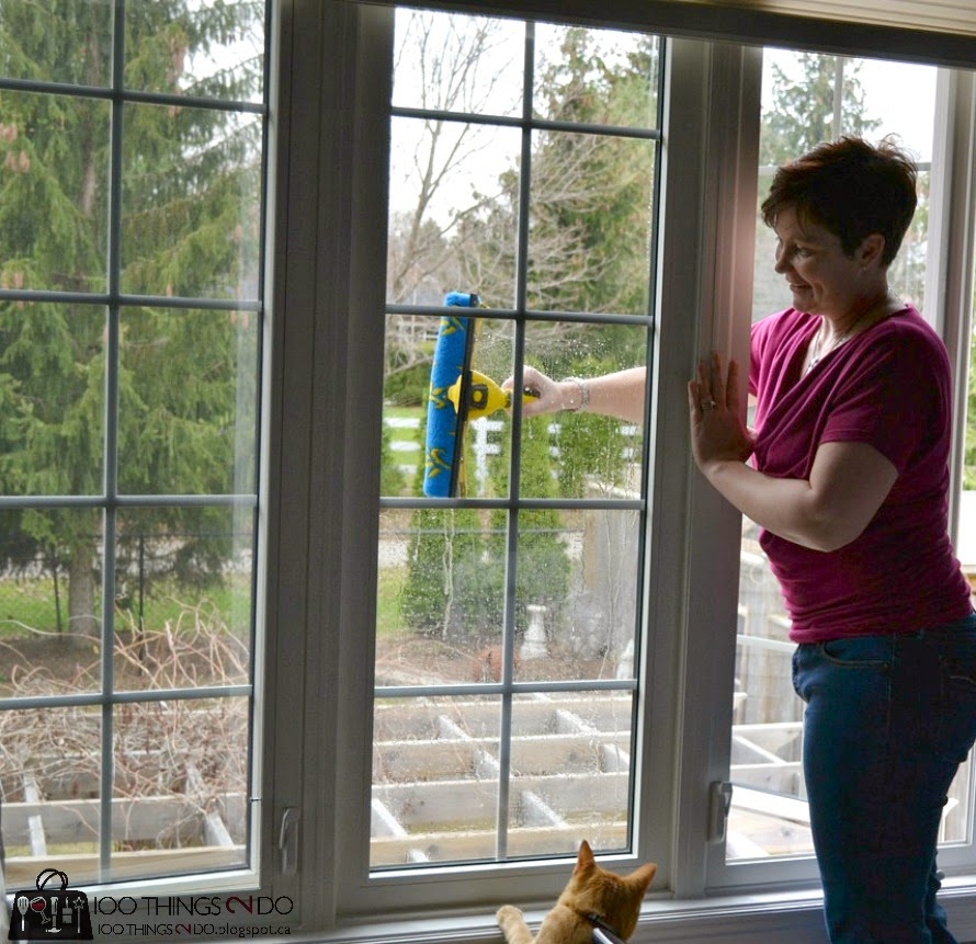 Clean second storey windows with a squeegee and extension pole