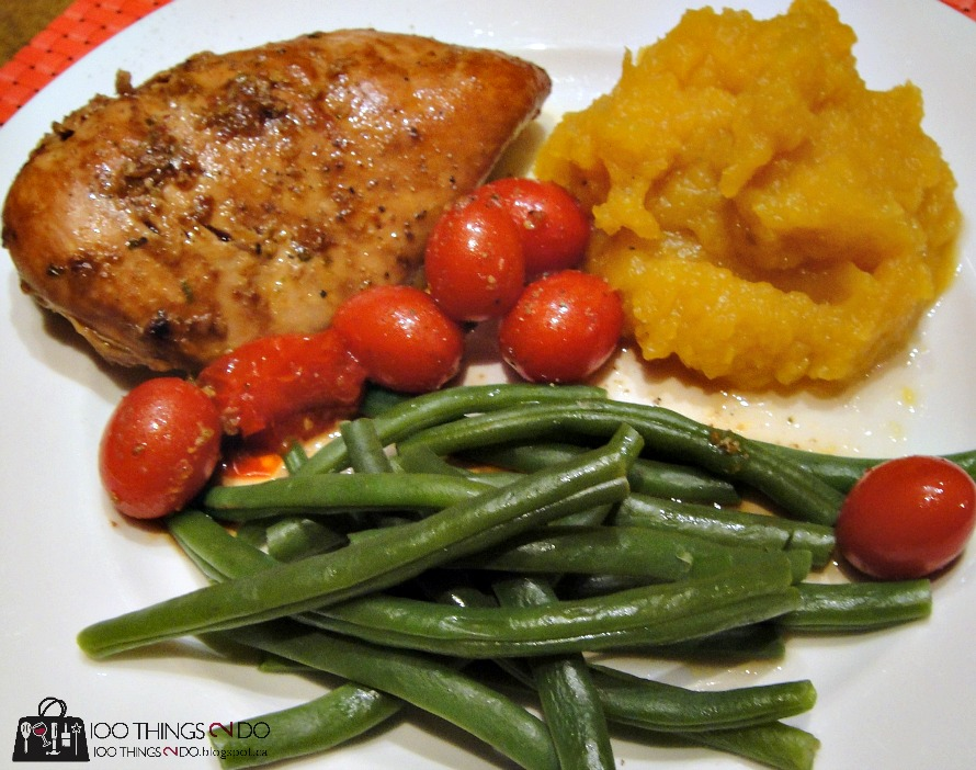 dinner plate with chicken green beans cherry tomatoes and squash on it