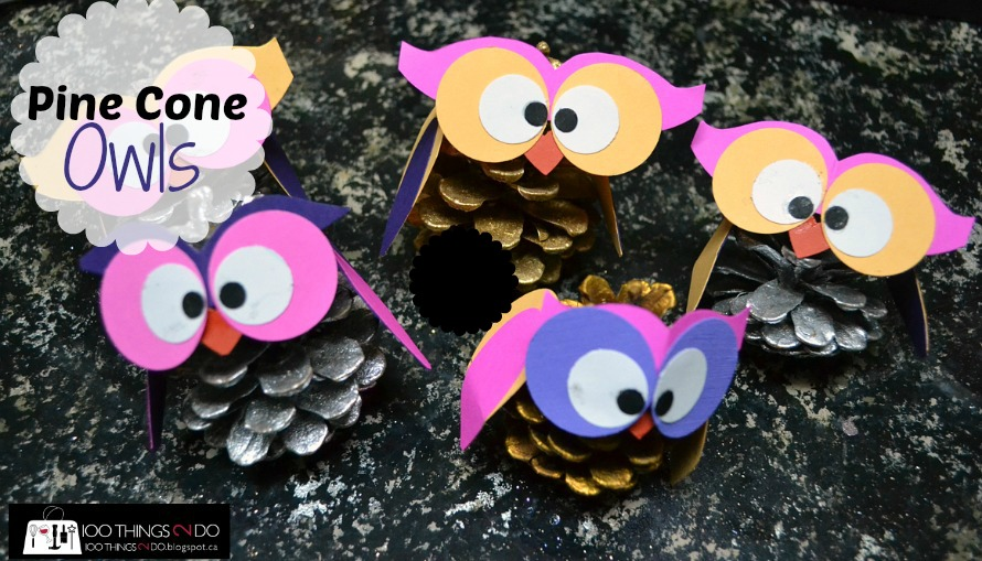 small pinecones with owl eyes, wings and beaks made from construction paper