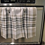 tea towel with snaps hanging over oven handle