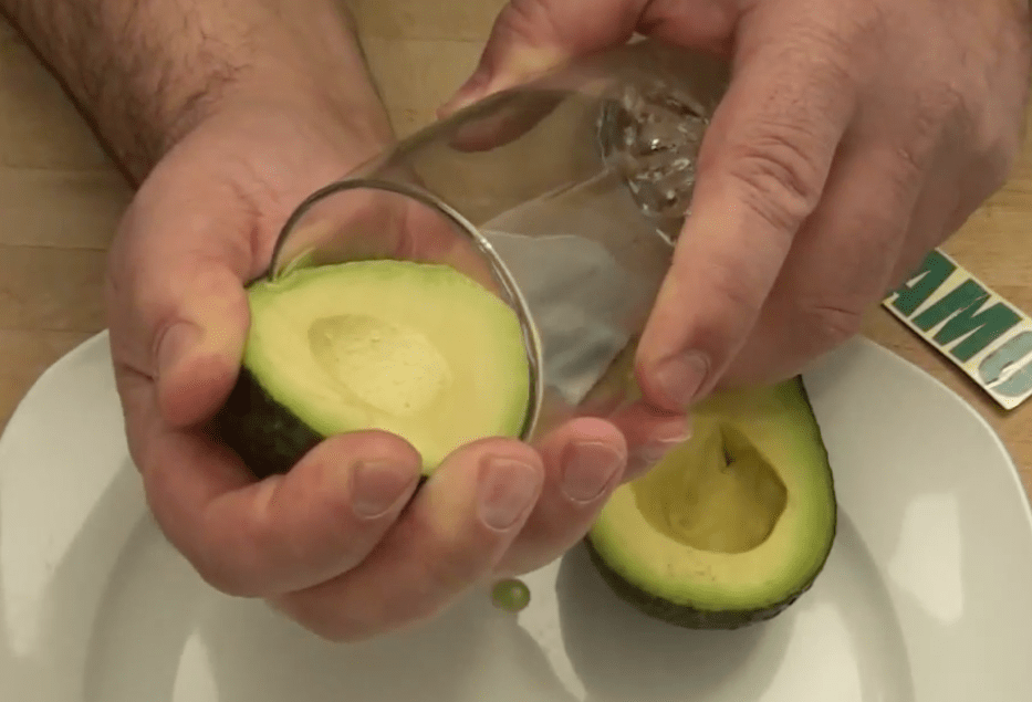 Peel an avocado with a glass