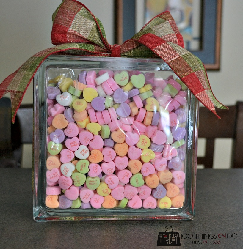 Candy-filled glass block with bow on top