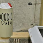 Upcycled cocoa tin to Doodie Duty container by the litter box