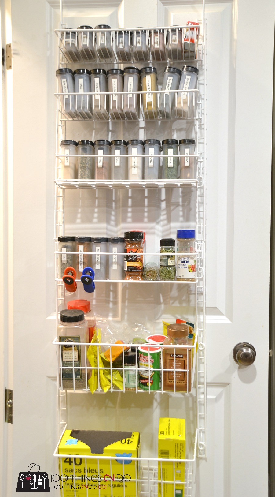 We have so many spice containers bags bottles and jars that the rack no longer sits flush against the door and instead sort of swings every time we open