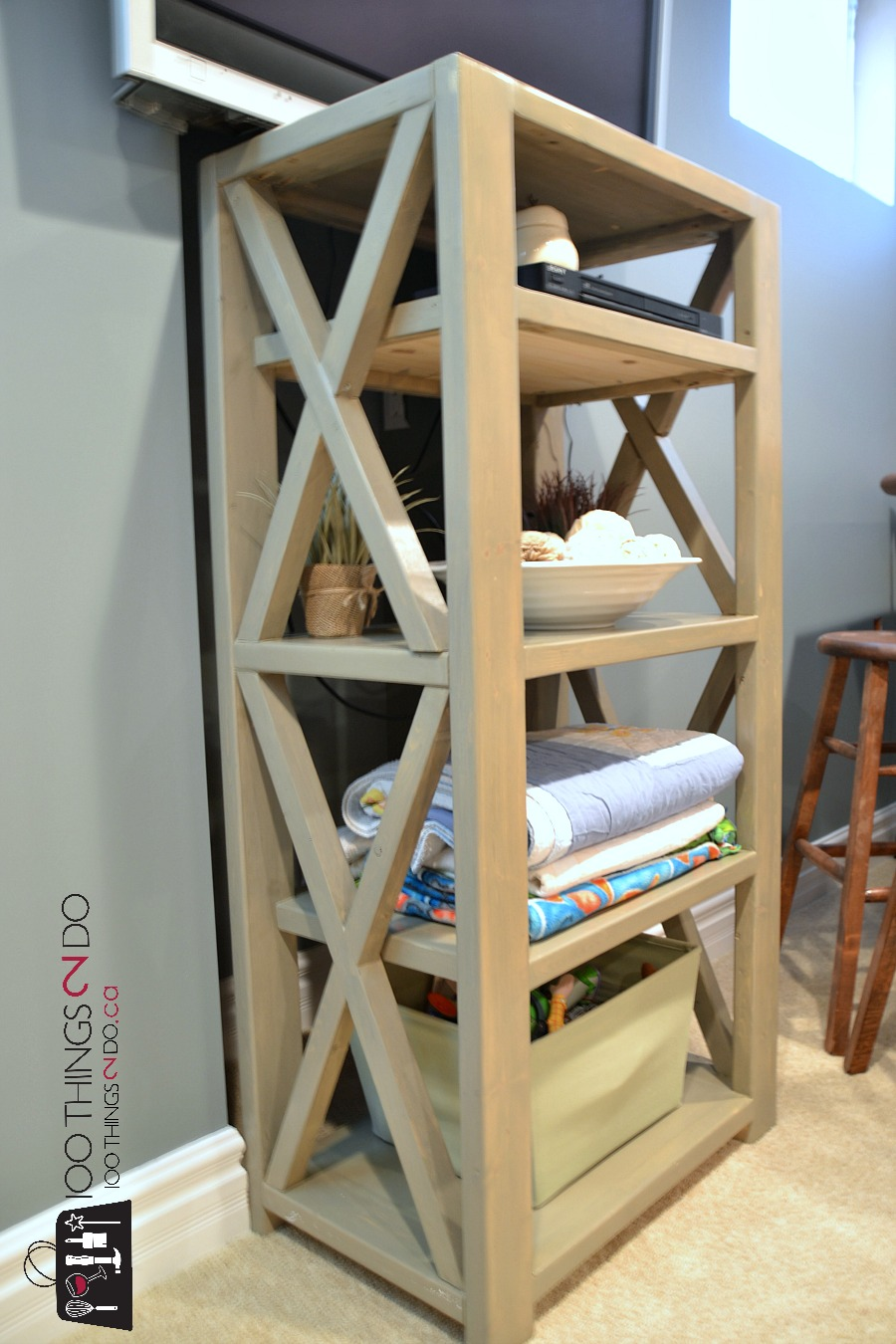 DIY Rustic X Bookshelf, DIY bookshelf, Ana White Rustic X, $21 DIY bookshelf, build your own bookshelf, farmhouse bookshelf
