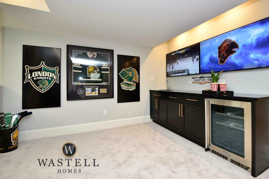 Man cave, sports room, rec room, hockey room, gray owl Benjamin Moore, dream home, model home, Wastell homes