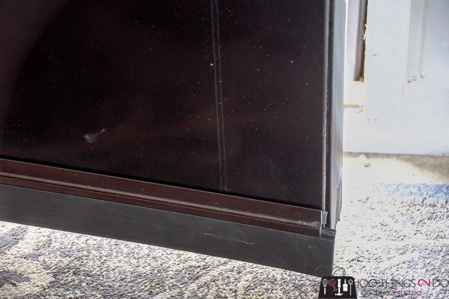 Attaching Cinch door sweep to the base of front door