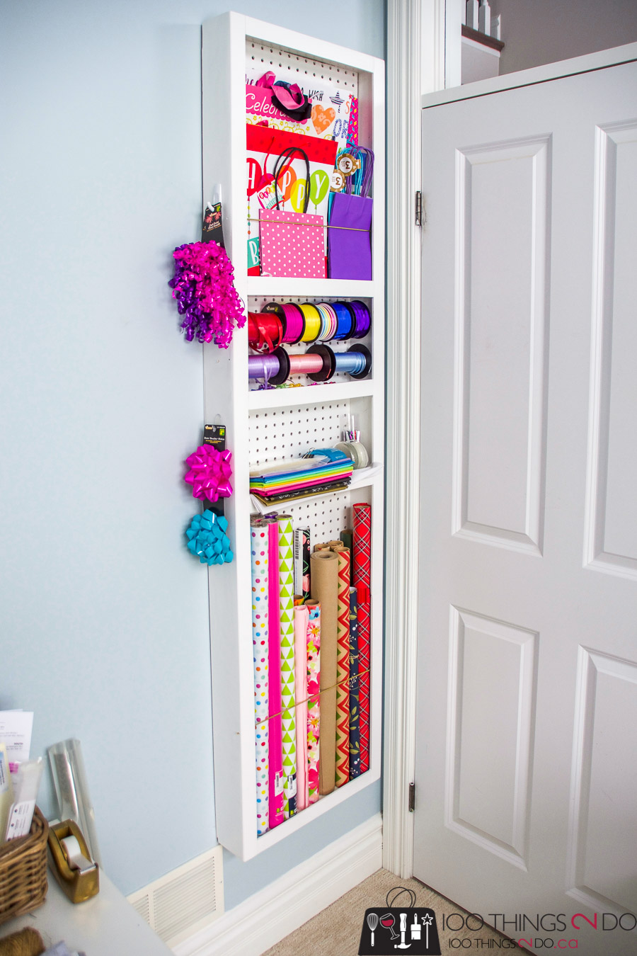 Behind-the-door-storage, behind the door storage rack, DIY door storage, gift wrap storage, wrapping paper storage, wrapping paper organization, organizing gift wrap