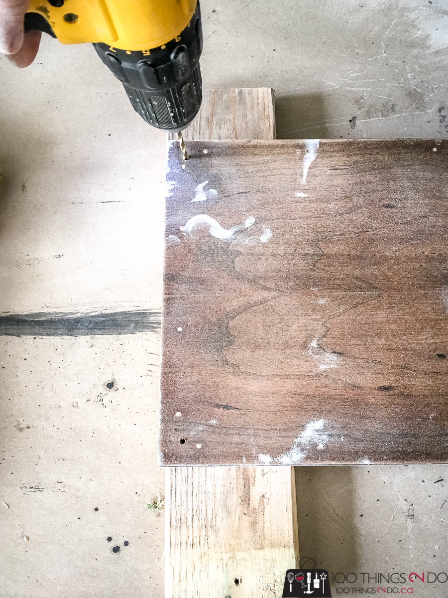 drilling holes into the back of a cupboard door