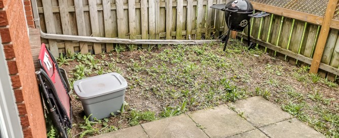 Before photo of backyard makeover
