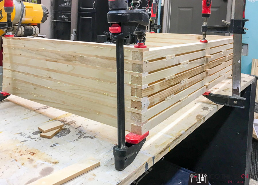 assembling the slats for the plant shelf