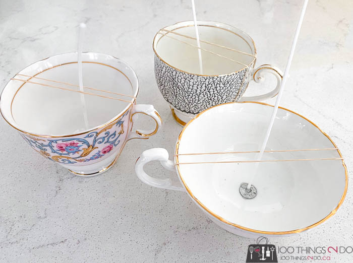 placing candle wicks in bottom of teacups
