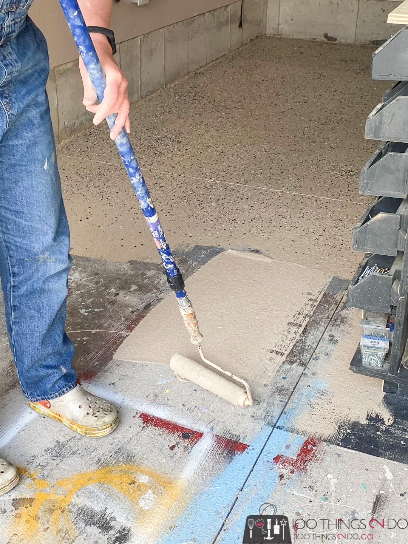 applying EpoxyShield to a garage floor