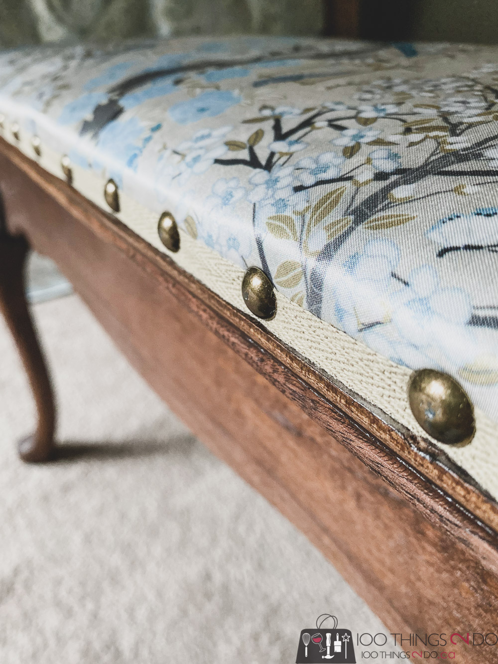 reupholstering an antique footstool