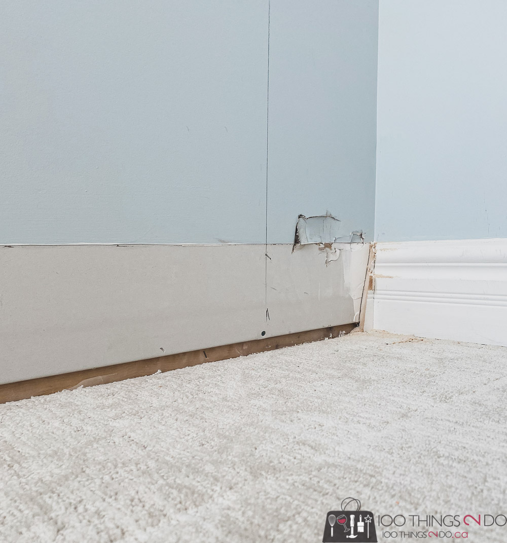removing baseboards with a prybar