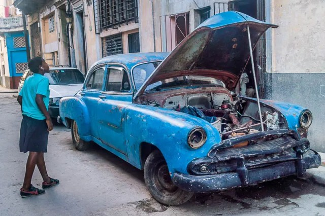Old car being repaired in Havana