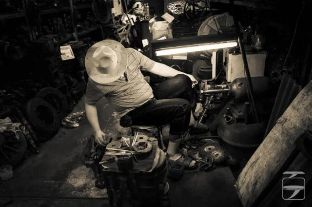 Man with interesting hat in the workshop