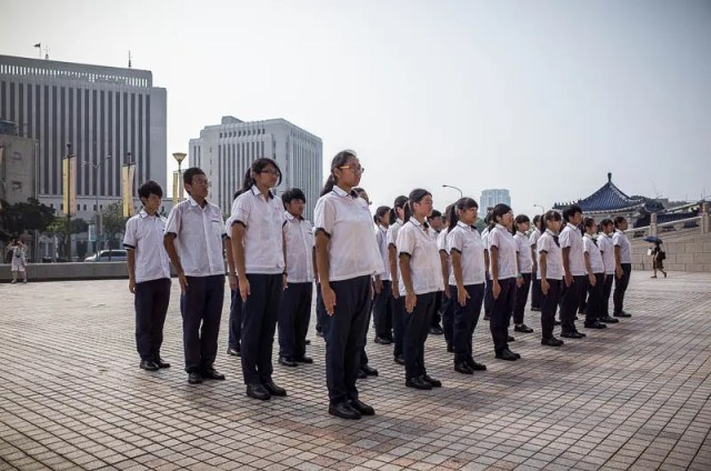 Students training for parade in front of the National Theater