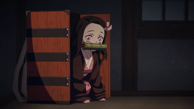 Nezuko emerges from her box