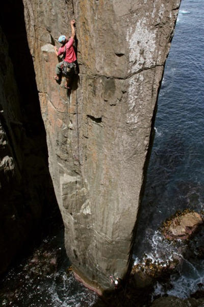 Erik Carleberg, of Sweden, nearing the top of The Totem Pole's first pitch variation, 24, and thankful for not dropping any bolt plates into the ocean.