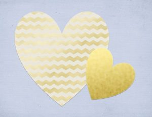 blue background with two gold hearts
