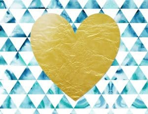 gold heart on a blue and white background