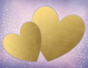 two gold hearts on a pretty background