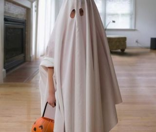 A perfectly acceptable Halloween costume: two eye-holes punched in a sheet to make a ghost costume.