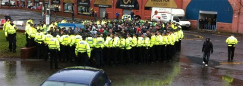 Young celtic fans being 'kettled' on their way to a football match. Scotland, March 2013.