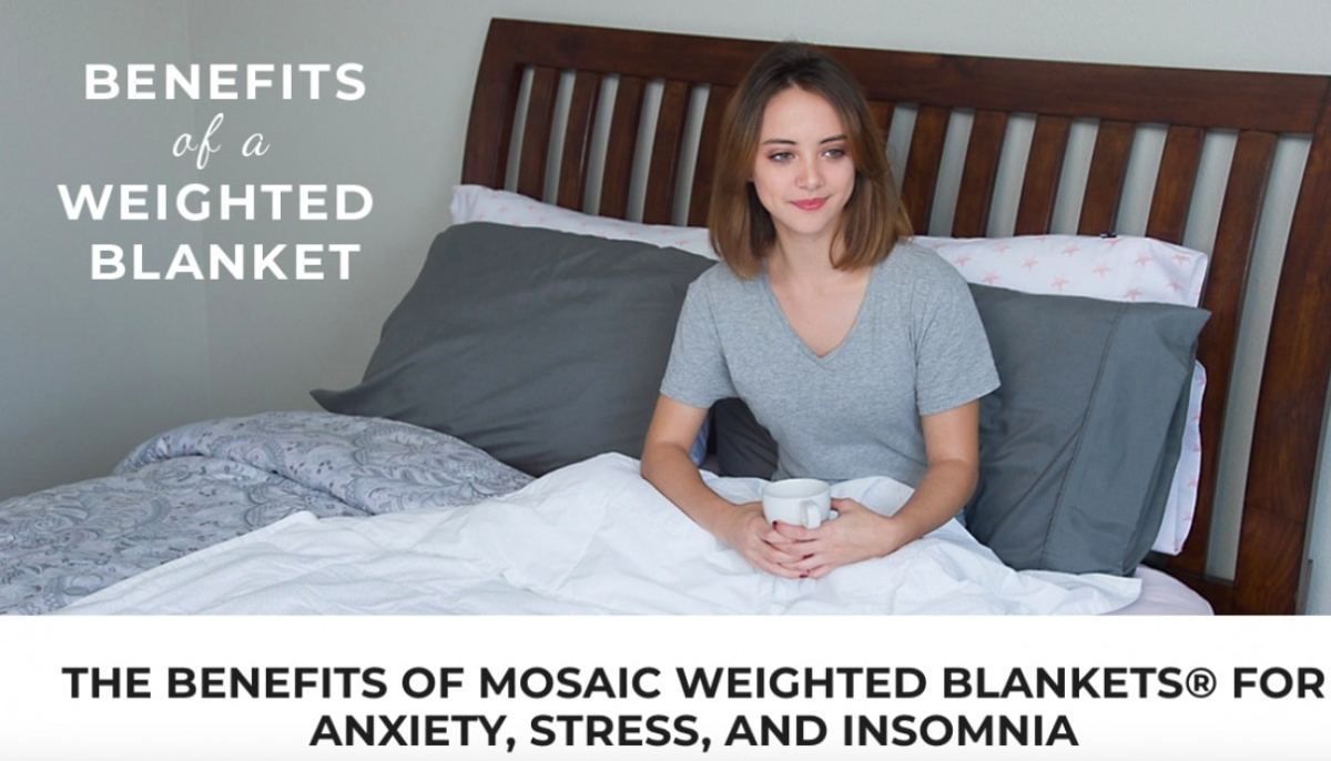 woman in bed with weighted blanket