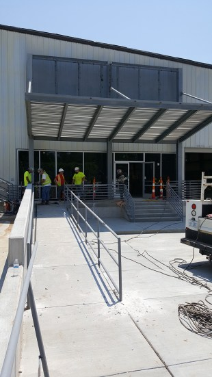 Guardrails and handrails installed at front entry