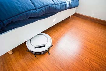 Robot vacuum cleaner cleaning under a bed