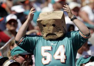 MIAMI - OCTOBER 24: A Miami Dolphins Fan wears a bag with a frown drawn on it during the game against the St. Louis Rams on October 24, 2004 at Pro Player Stadium in Miami, Florida. (Photo by Eliot J. Schechter/Getty Images)