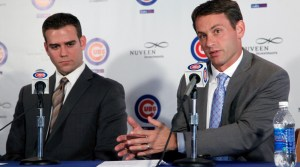 Chicago Cubs president of baseball operations Theo Epstein, left, listens to new executive vice president/general manager Jed Hoyer, during a news conference Tuesday, Nov. 1, 2011 in Chicago. Hoyer reunites with Epstein where the pair worked in Boston. (AP Photo/Charles Rex Arbogast)