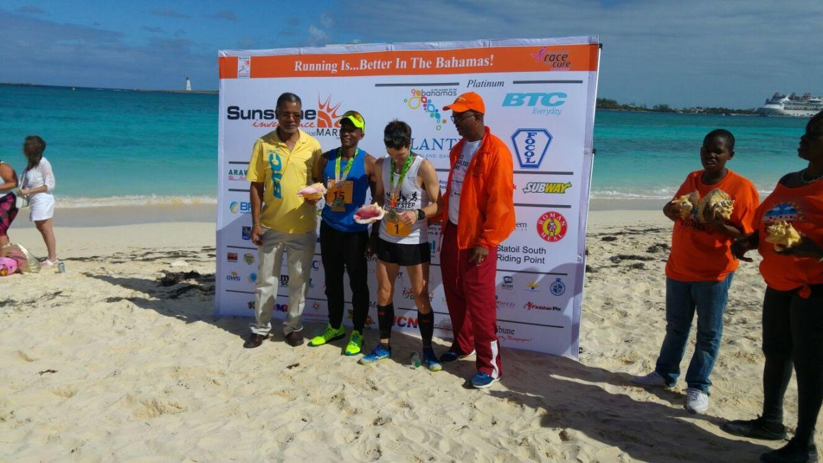 Antoine Bosfield pictured second from left accepting his award for placing 2nd in his age category at the Sunshine Insurance Marathon Bahamas marathon January 15, 2017.