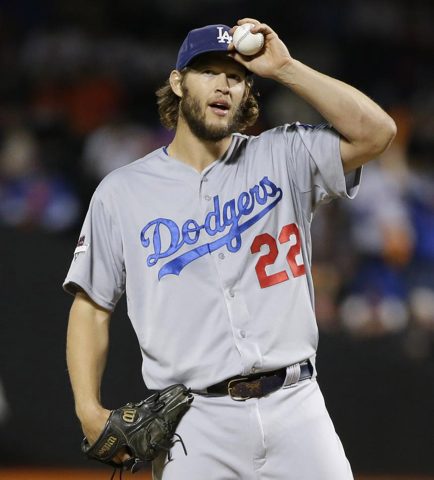 Los Angeles Dodgers pitcher Clayton Kershaw (22) adjusts his cap between pitches against the New York Mets during the first inning of baseball's Game 4 of the National League Division Series, Tuesday, Oct. 13, 2015, in New York. (AP Photo/Frank Franklin II)