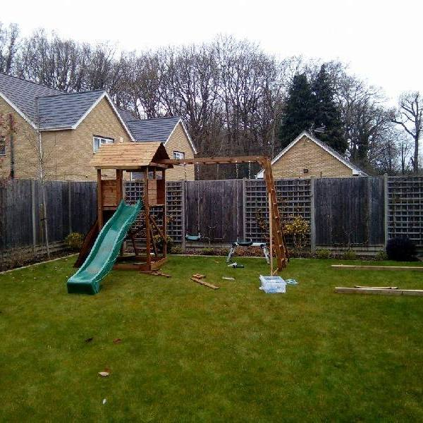 New Assembled Climbing frame with swing and slide set in a garden