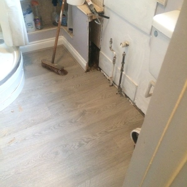 Shower room with new laminate flooring installed
