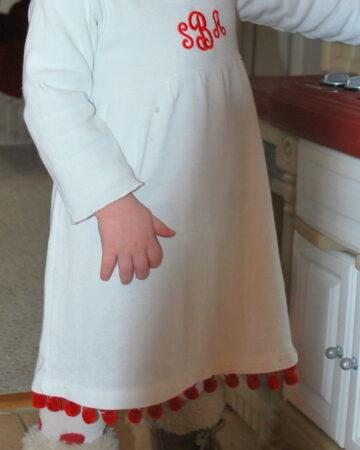 White Christmas dress with red pompom fringe