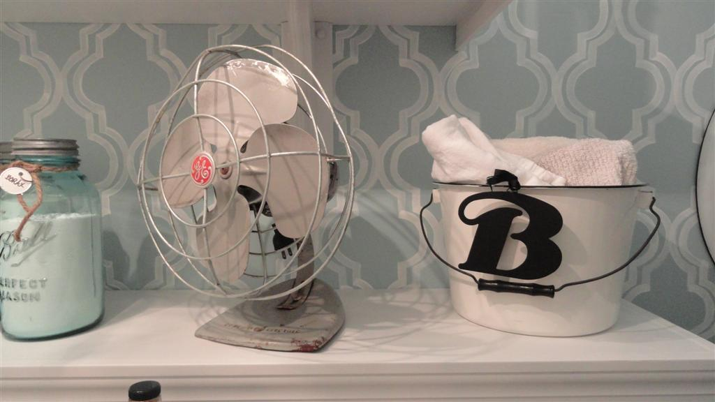 The fan was $2 at a yard sale (it still works) and the enamel bucket holds my cleaning rags.