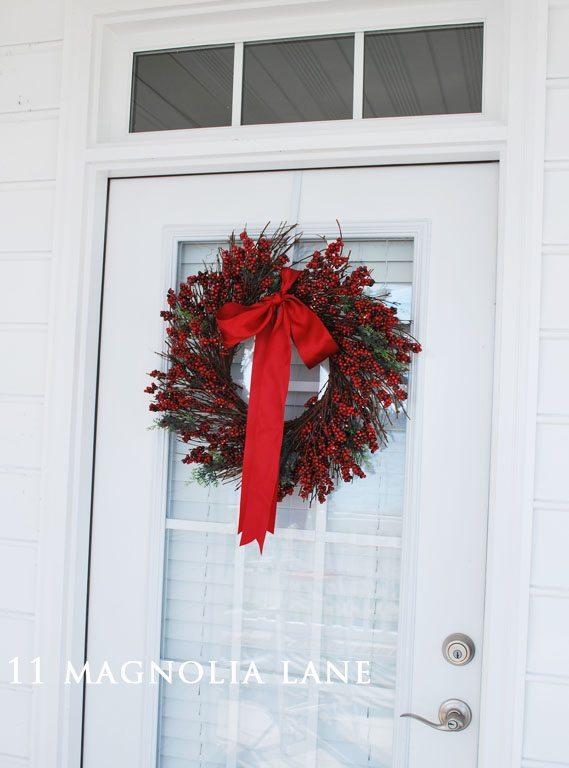 Red holly wreath door