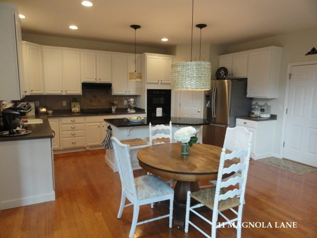 white kitchen redo after oak pedestal table
