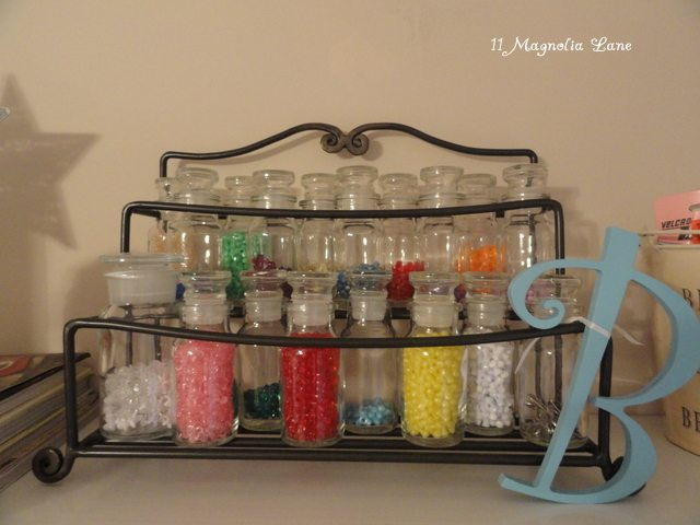 spice rack (with spice bottles) to organize beads and small craft items