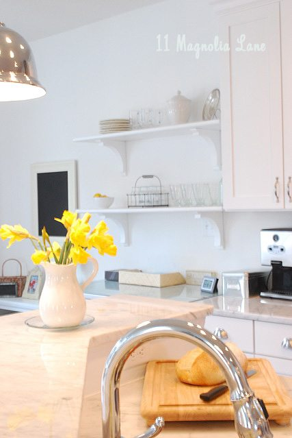 white kitchen with pops of yellow