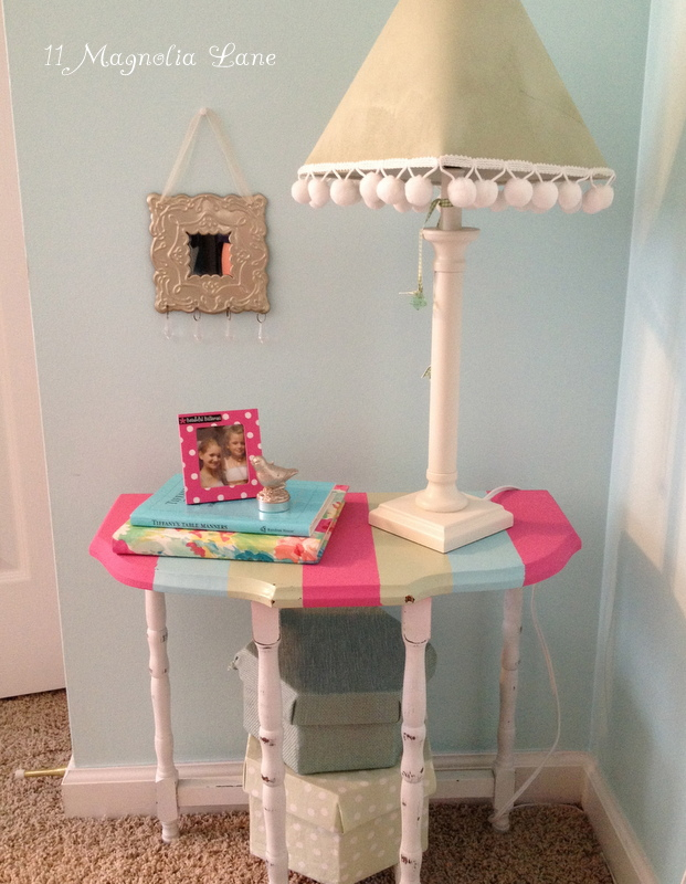 Pink, green, and aqua blue striped table