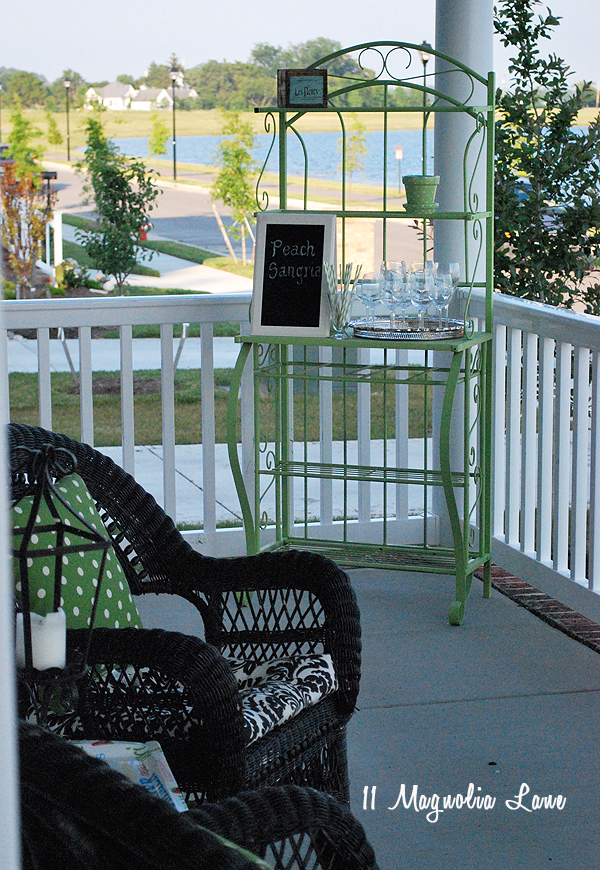 Baker's rack spray painted a bright color and used as a drink bar on the porch