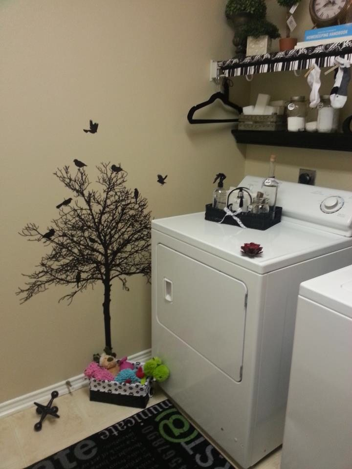 Black vinyl tree in laundry room