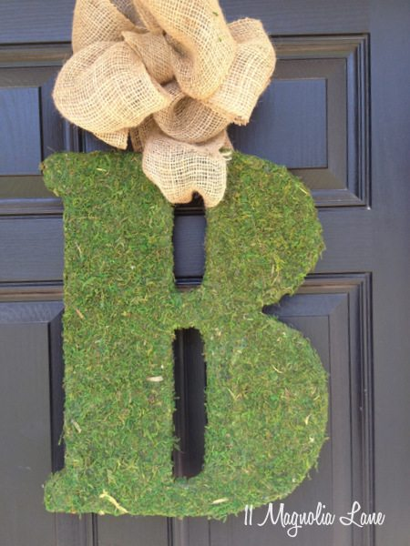 Moss covered initial with burlap ribbon